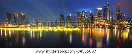 SINGAPORE - DECEMBER 31: Beautiful panorama of Singapore city at Marina Bay taken on December 31, 2009 in Singapore. This evening marks the countdown party at the bay to usher in the new year. - stock photo
