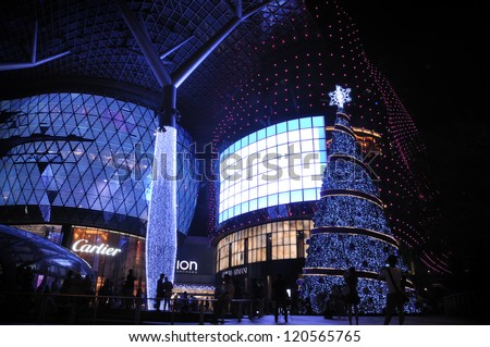 SINGAPORE - DECEMBER 1: Christmas Decoration at Singapore Orchard Road on December 1, 2012 in Singapore. The street with twinkling lights and dressed-up shopping centres. - stock photo