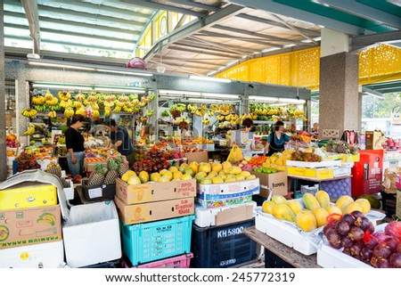 SINGAPORE - DECEMBER 11: Local residents shopping for fruits and vegetables at a local wet market Dec. 11, 2014, in Singapore. A wet market is the place to buy groceries and the freshest produce.