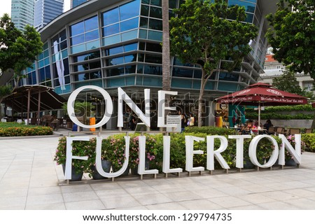 SINGAPORE - DECEMBER 27: The Fullerton Hotel Singapore on December 27, 2012 in Singapore. The Fullerton Hotel Singapore is a five-star boutique hotel with address 1 Fullerton Square. - stock photo