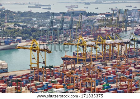 SINGAPORE - DECEMBER 07: The port of Singapore on December 07, 2013 in Singapore. It's the world's busiest transshipment port and the world's second-busiest port in terms of total shipping tonnage. - stock photo