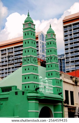 Singapore - December 14, 2007:  Twin minarets flank the street facade of the 1826 Jamae Chulia Mosque on South Bridge Road in Chinatown - stock photo