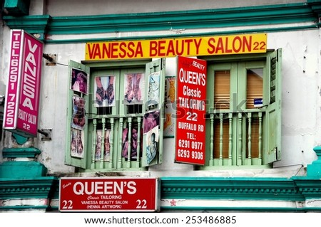 Singapore - December 17, 2007: Two Indian businesses, a beauty salon and tailor, occupy a shop house on Buffalo Road in Little India - stock photo