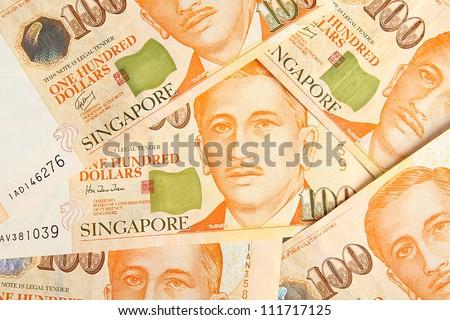 Singapore dollars background. - stock photo