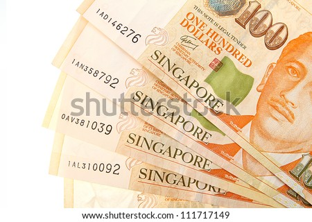 Singapore Dollars on a white background. - stock photo