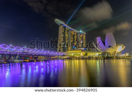 SINGAPORE -Feb 27: Largest and most beautiful laser show at the Marina Bay waterfront in Singapore. Wonderful laser show and water spectacular in Southeast Asia on Feb 26, 2016,  - stock photo