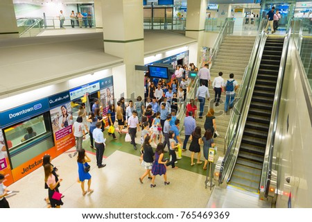SINGAPORE - FEB 16, 2017: Passengers living a MRT train at a station. The MRT network encompasses 199.6 kilometres of route, with 119 stations in operation