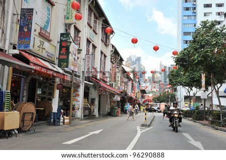 SINGAPORE - FEB 11: Street scene in Singapore's Chinatown as the city state welcomes in Chinese New Year on Feb 11, 2012 in Singapore. The city's ethnic Chinese began settling in Chinatown circa 1820. - stock photo