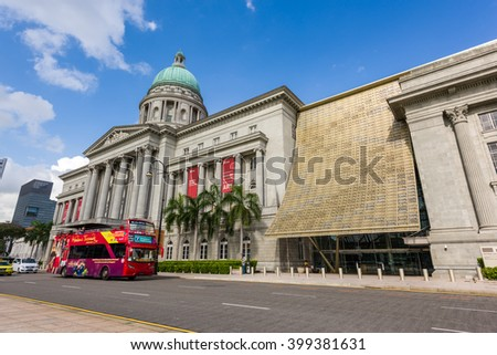 Singapore, 26 Feb 2016: Tourist bus driving past the National Art Gallery. It consists of the former Supreme Court Building and City Hall. - stock photo