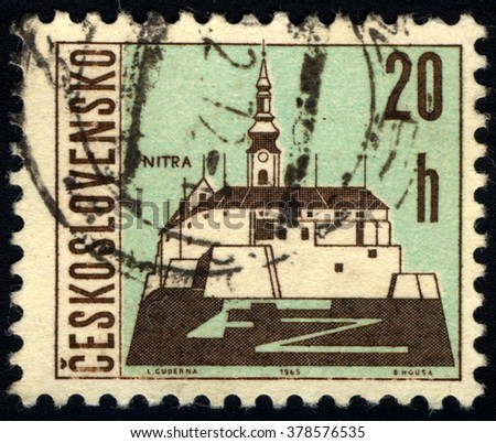 SINGAPORE - FEBRUARY 19,  2016: A stamp printed in Czechoslovakia, shows the city of Nitra, circa 1965 - stock photo