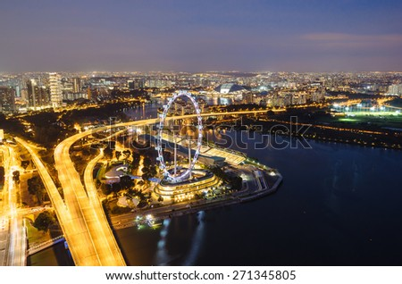 SINGAPORE - February 22, 2015: Aerial view on Singapore Flyer  - stock photo