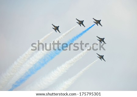 SINGAPORE - FEBRUARY 9: Aerobatic flying display by Black Eagles from the Republic of Korean Air Force (ROKAF) at Singapore Airshow February 9, 2014 in Singapore
