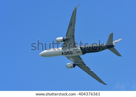 SINGAPORE - FEBRUARY 16:  Airbus A350-900 on aerial display at Singapore Airshow February 16, 2016 in Singapore - stock photo