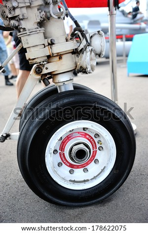 SINGAPORE - FEBRUARY 14: Airplane wheel on the ground at Singapore Airshow 2014, Asias Biggest For Aviations Finest at Changi Exhibition Centre on February 14, 2014 in Singapore.