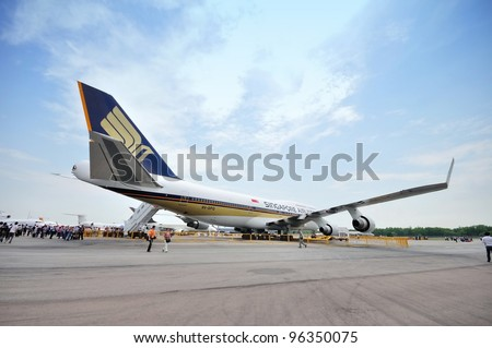SINGAPORE - FEBRUARY 17: Back of Singapore Airlines (SIA) last Boeing 747-400 aircraft at Singapore Airshow on February 17, 2012 in Singapore - stock photo