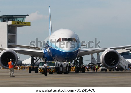 SINGAPORE - FEBRUARY 14: Boeing 787 Dreamliner on display during Singapore Airshow at Changi Exhibition Centre in Singapore on February 14, 2012. - stock photo