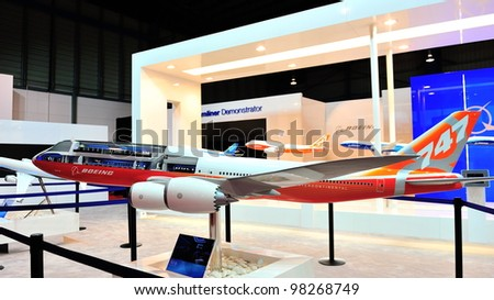 SINGAPORE - FEBRUARY 17: Boeing 747-800 Intercontinental model plane on display at Singapore Airshow February 17, 2012 in Singapore - stock photo