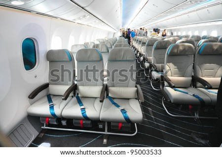 SINGAPORE - FEBRUARY 12: Economy class seats in a Boeing 787 Dreamliner at Singapore Airshow February 12, 2012 in Singapore