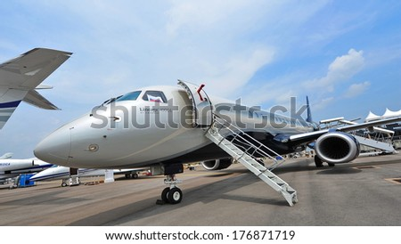 SINGAPORE - FEBRUARY 9: Embraer Lineage 1000E executive jet on display at Singapore Airshow February 9, 2014 in Singapore
