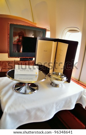 SINGAPORE - FEBRUARY 17: First class cabin cavier bowl and cake tray in Singapore Airlines' (SIA) last Boeing 747-400 aircraft at Singapore Airshow on February 17, 2012 in Singapore - stock photo