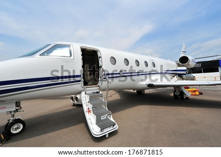SINGAPORE - FEBRUARY 9: Gulfstream G150 business jet with its door opened at Singapore Airshow February 9, 2014 in Singapore - stock photo