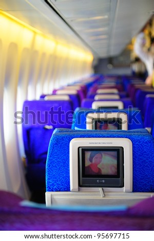 SINGAPORE - FEBRUARY 12: Inflight entertainment system in economy class cabin in Singapore Airlines' (SIA) last Boeing 747-400 aircraft at Singapore Airshow February 12, 2012 in Singapore - stock photo