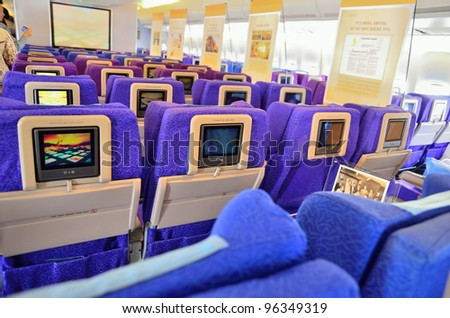 SINGAPORE - FEBRUARY 17: Inflight entertainment system in economy class cabin in Singapore Airlines' (SIA) last Boeing 747-400 aircraft at Singapore Airshow on February 17, 2012 in Singapore - stock photo