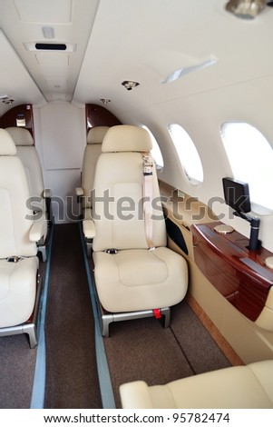 SINGAPORE - FEBRUARY 12: Interior of Phenom 300 Embraer with comfortable leather seats on display at Singapore Airshow on February 12, 2012 in Singapore