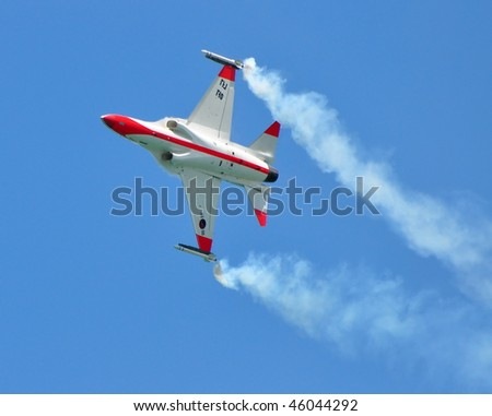 SINGAPORE - FEBRUARY 03: KAI T/A-50 Golden Eagle performing stunts during Singapore Airshow February 03, 2010 in Singapore - stock photo