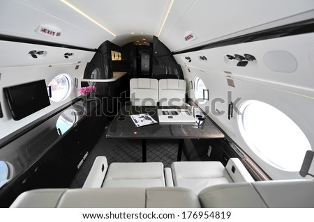 SINGAPORE - FEBRUARY 12: Luxurious interior of Gulfstream G450 executive jet at Singapore Airshow February 12, 2014 in Singapore - stock photo