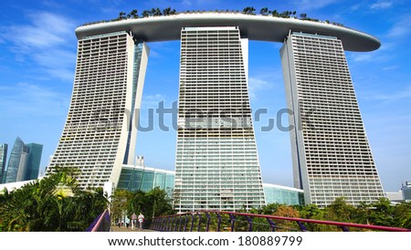 SINGAPORE - FEBRUARY 04, 2014: Marina Bay Sands. The iconic design has transformed Singapore's skyline and tourism landscape since it opened on 27 April 2010. Designed by architect Moshe Safdie.  - stock photo