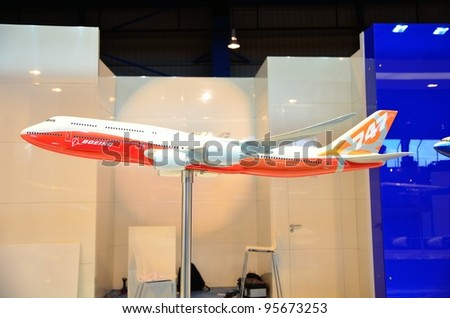 SINGAPORE - FEBRUARY 12: Model of Boeing 747-800 jumbo jet on display at Singapore Airshow on February 12, 2012 in Singapore - stock photo