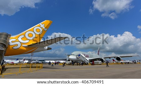 SINGAPORE - FEBRUARY 16:  Qatar Airways A380 super jumbo behind the Scoot Boeing 787 Dreamliner at Singapore Airshow February 16, 2016 in Singapore - stock photo