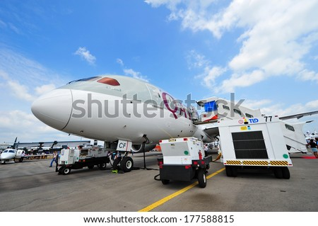 SINGAPORE - FEBRUARY 12: Qatar Airways Boeing 787-8 Dreamliner on display at Singapore Airshow February 12, 2014 in Singapore - stock photo