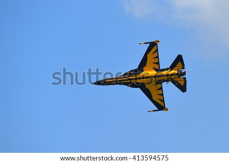 SINGAPORE - FEBRUARY 16:  RKAF Black Eagles Aerobatic Team aerobatic performance at Singapore Airshow February 16, 2016 in Singapore - stock photo