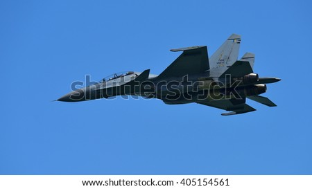 SINGAPORE - FEBRUARY 16:  Royal Malaysia Air Force Sukhoi Su-30MKM fighter performing stunts at Singapore Airshow February 16, 2016 in Singapore - stock photo