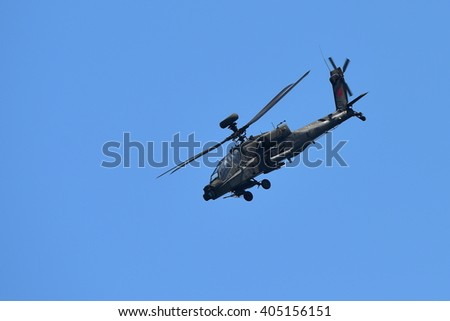SINGAPORE - FEBRUARY 16:  RSAF AH-64D Apache helicopter performing aerobatics at Singapore Airshow February 16, 2016 in Singapore - stock photo