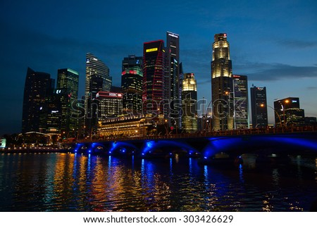 SINGAPORE - FEBRUARY 22: Singapore downtown cityscape on February 22, 2013 in Singapore. Singapore downtown with business area, hotels and casinos is main tourist attraction of the city. - stock photo