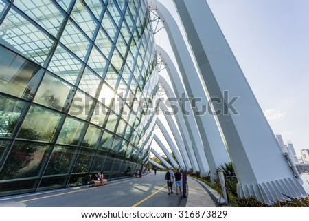SINGAPORE - FEBRUARY 28, 2015: Sunset scene of the Flower Dome at Garden by the Bay. Garden by the Bay is one of the most famous tourist attraction in Singapore. - stock photo