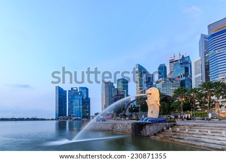SINGAPORE-FEBRUARY, 18- The Merlion fountain and Marina Bay with sunrise morning Feb 18, 2014.Merlion is a mythical creature with the head of a lion and the body of a fish,and is a symbol.