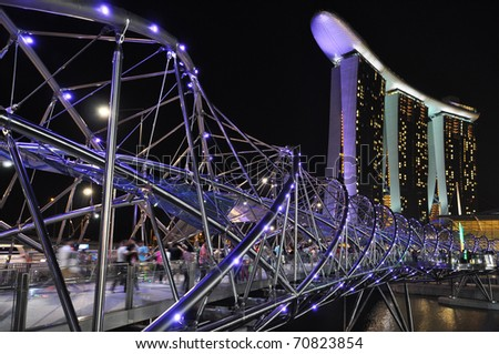 SINGAPORE - FEBRUARY 4: The new Marina Bay Sands resort and Helix Bridge on February 4, 2011 in Singapore