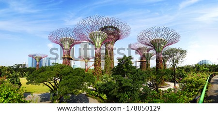 SINGAPORE - FEBRUARY 04, 2014: The Supertree Grove at Gardens by the Bay. These unique Supertrees are tall � up to 16 storeys in height, created by UK landscape architects Grant Associates.  - stock photo