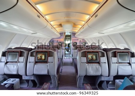 SINGAPORE - FEBRUARY 17: Top deck business class cabin and cockpit in front in Singapore Airlines' (SIA) last Boeing 747-400 aircraft at Singapore Airshow on February 17, 2012 in Singapore - stock photo