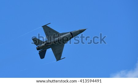 SINGAPORE - FEBRUARY 16:  USAF F-16C/D Fighting Falcon performing aerial display at Singapore Airshow February 16, 2016 in Singapore - stock photo