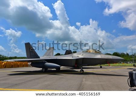SINGAPORE - FEBRUARY 16:  USAF Lockheed Martin F-22 Raptor on display at Singapore Airshow February 16, 2016 in Singapore - stock photo