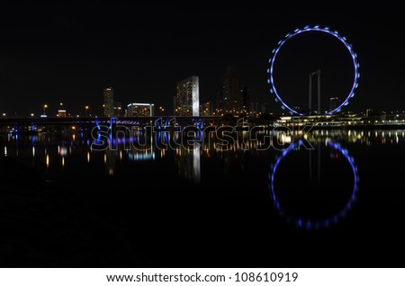 Singapore flyer and skyline - stock photo