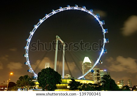 Singapore Flyer at night - the Largest Ferris Wheel in the World. - stock photo