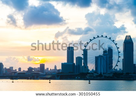 Singapore flyer on sunset times