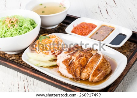 singapore hainan chicken rice set with fresh soup, sauce and vegetables - stock photo