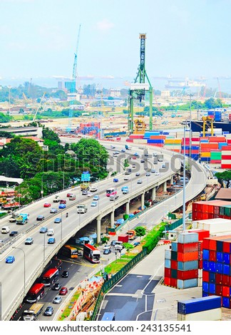 Singapore highway near commercial port . It's the world's busiest port in terms of total shipping tonnage, it transships a fifth of the world shipping containers  - stock photo